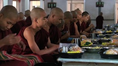 Hundreds Buddhist monks eating lunch at Monastery in Mandalay , Myanmar, Burma Stock Footage