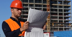 Inspector Workplace Engineer Man Look Out Examine Draft Map of Modern Building Stock Footage