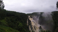 A Barron falls waterfall in the rain forest in Kuranda, Queensland, Austra Stock Footage