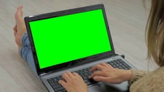Woman using laptop with green screen Stock Footage