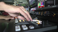 Hand operating a video switcher in broadcasting van Stock Footage