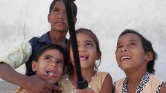 Kids taking selfies with a selfie stick in India Arkistovideo