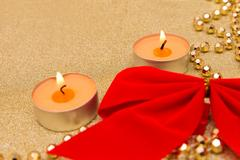 New year composition: paper, bow, chaplet and candles Stock Photos