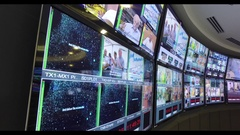 TV screens in a satellite media center Stock Footage