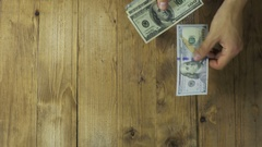Man Hands Consider Dollar Banknotes on a Wooden Table Stock Footage