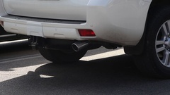 Exhaust pipe running car Stock Footage