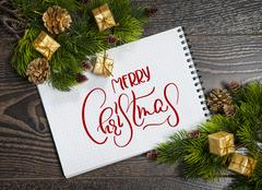 Holiday blank note with text Merry Christmas. Calligraphy and lettering Stock Photos