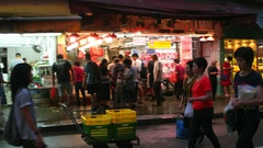HONG KONG -  Evening view of wet market with people. 4K resolution panning. Stock Footage