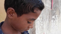 Indian kids talking on mobile cell phone Stock Footage