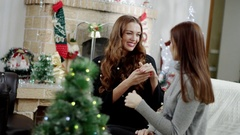 Woman showing a ring presented to christmas Stock Footage