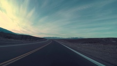 Driving On Empty Road In Desert, Car Headlights In The Distance At End Of Clip Stock Footage
