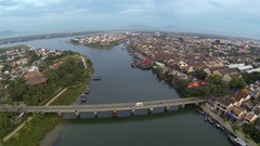 Aerial view over the bridge of Hoi Ann Stock Footage