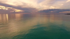 Aerial shot, incredibly beautiful calm sea in the sunset light with lots  Stock Footage