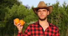 Exotic Field Worker Man Posing and Holding Organic Oranges Farmer Looking Camera Stock Footage