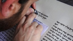 Sofer writes a sefer Torah in Hebrew Stock Footage