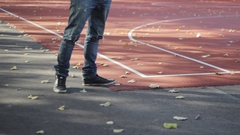 A young man walking away from the playground. Autumn time Stock Footage