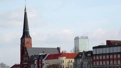 Church, apartment buildings, Allianz skyscraper, Berlin skyline, Germany Stock Footage