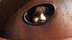 Little girl play hide and seek Stock Footage