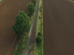 4K Arial shot. Girl Running in Rural Area surrounded by fields Stock Footage