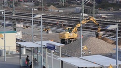 Earthmover moves earth at railroad track construction site, Berlin, Germany Stock Footage