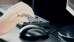 Male hand holding computer mouse with laptop keyboard in the background Stock Footage