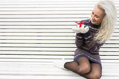 Young Modern Girl with a Gift Stock Photos