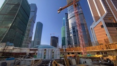 Tower cranes on construction site before skyscrapers timelapse. Moscow, Russia Stock Footage