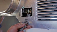 Electricians hands installing a new dryer Stock Footage