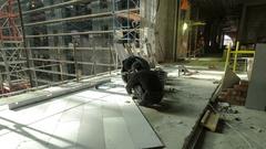 Industrial tiler builders workers installing floor tile at repair renovation Stock Footage