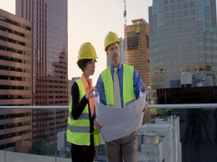 Architect and contractor consult plans in Downtown Los Angeles MLS 4K Stock Footage