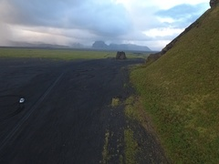 Rental car Iceland Travel on the Black Sand Stock Footage