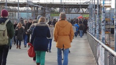 Crowd of people walk in busy city, Warschauer station, Berlin, Germany Stock Footage