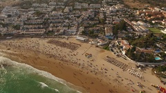 Aerial. Video shot from the sky, town beach and summer Luz Stock Footage