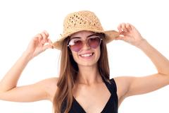 Beautiful girl in straw and sunglasses Stock Photos