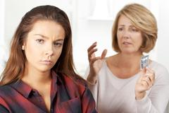 Mother Talking To Teenage Daughter About Contraception Stock Photos