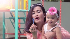 Mother-daughter-blowing-bubbles-HD1080 24fps Stock Footage