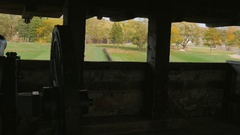 Silhouette of an old cannon at Fort Niagara. Its trunk looks at trees Stock Footage