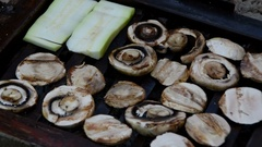 Mushrooms and zucchini on the grill Stock Footage