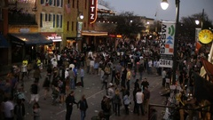 Time lapse shot people walking at night on 6th Street during SXSW music Stock Footage