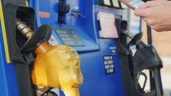 Man pays with credit card and enters a PIN code at a gas station. Automatic Stock Footage