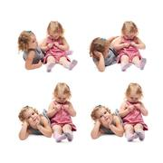 Couple of young little girl sitting over isolated white background Stock Photos