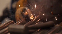A slow motion shot of a welder working in the machine shop Stock Footage