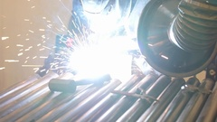 A slow motion shot of welder working in the machine shop Stock Footage