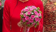 Closeup Girl in Red Holds Wedding Pink Rose Bouquet Stock Footage