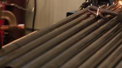 A welder working in a machine shop Stock Footage