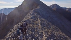 Drone Footage Of Men Hiking On Mountain Extreme Sport Landscape Travel Scenic Stock Footage