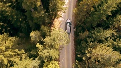 Slow Motion Footage Of Car Driving Through Forest Road Drone Travel Countryside Stock Footage