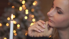 Woman Makes a Wish on Christmas Stock Footage