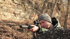 Civil man  with automatic rifle     Stock Footage