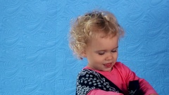 Adorable toddler girl play hide and seek with head scarf. closeup Stock Footage